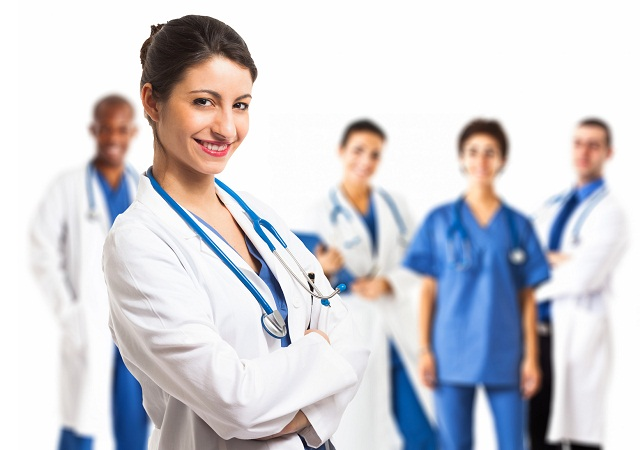 Portrait of a beautiful smiling doctor in front of her team